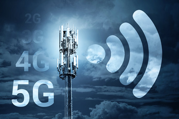With the power of 5G comes lower transmission potential. Pictured: the top of a communications mast stands to the right of the acronyms '2G', '3G', '4G', and (most prominently) '5G'. A radio-frequency symbol hovers on its right side.