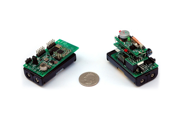 A close-up view on FireFly sensor nodes for utility monitoring and voice communication applications.