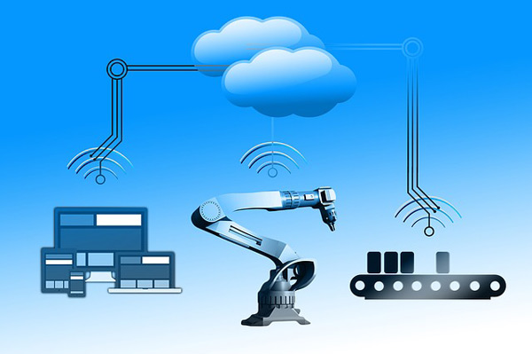 The ultra-low latency features of 5G are set to revolutionise the industrial internet of things (and much more). Pictured, left to right: graphics of four smart devices, a robotic arm, and a factory conveyor belt—each under an electronic communication symbol.