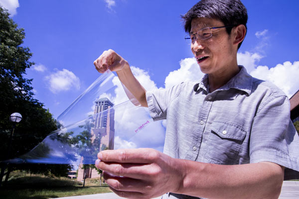 Jay Guo, a professor of Electrical Engineering and Computer Science at the University of Michigan (UMICH), holds his and his research team's flexible transparent conductor sheet on UMICH's College of Engineering North Campus.