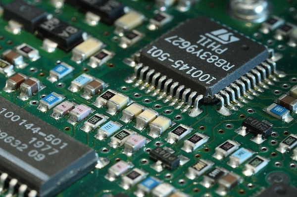 Printed circuit board with circuit components exposed.