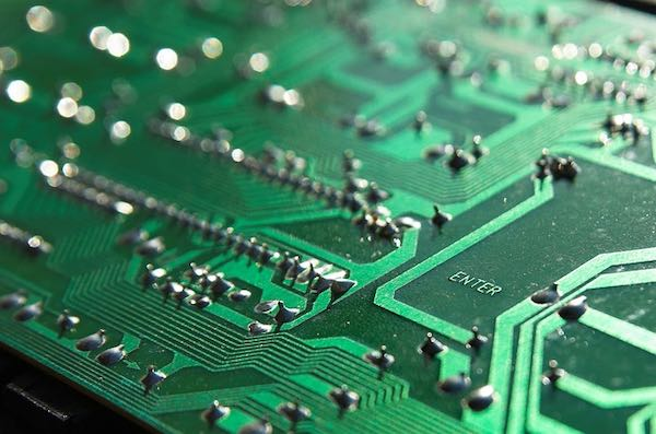 The reverse side of a printed circuit board.