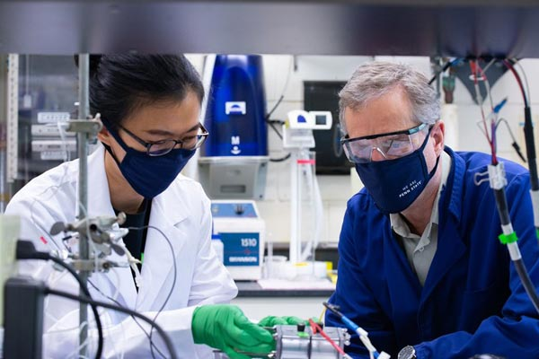 Left to right: Le Shi, postdoctoral researcher in environmental engineering and first author of the paper; and Professor Bruce Logan, from the Environmental Engineering department at Penn State. Together, both scientists examine their newly-designed seawater electrolyser.