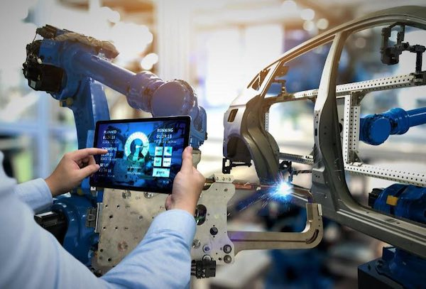 A tablet being used to assist in the monitoring of an automotive manufacturing process.