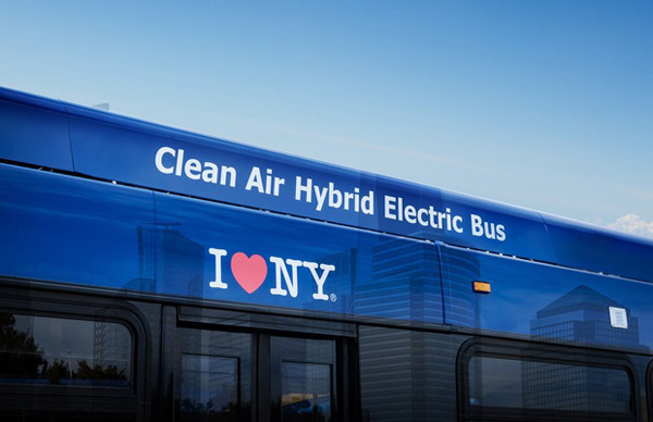 A close-up of the top of a New York City Transit Authority (NYCTA) bus, labelled 'Clean Air Hybrid Electric Bus' in connection with BAE Systems' provision of electric power systems to NYCTA's vehicles.