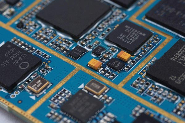 Aluminium oxide (aka alumina) is currently the most common material for electronics substrates. Pictured: a close-up of a mother board's chips that are packaged with black alumina.
