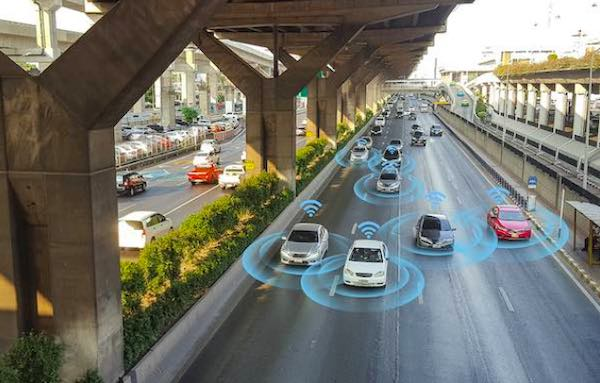 Autonomous vehicles on highway.