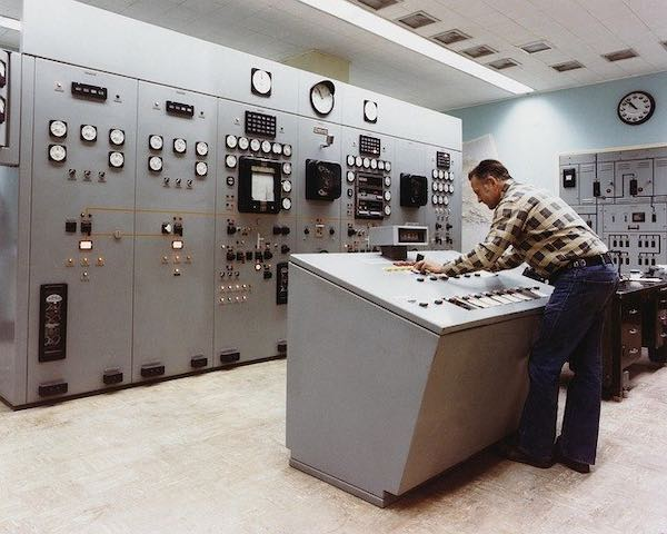 An engineer working in the control room of a power plant.