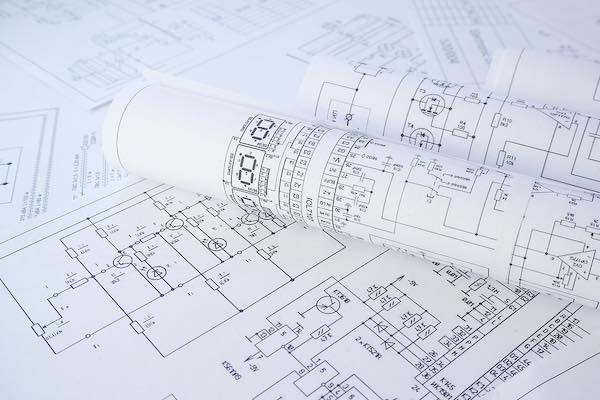 Printed drawings of electrical circuit schematics.