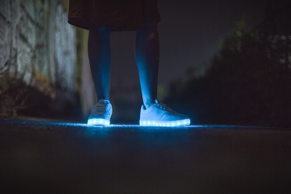 blue LEDs lighting up the soles of jogging shoes.
