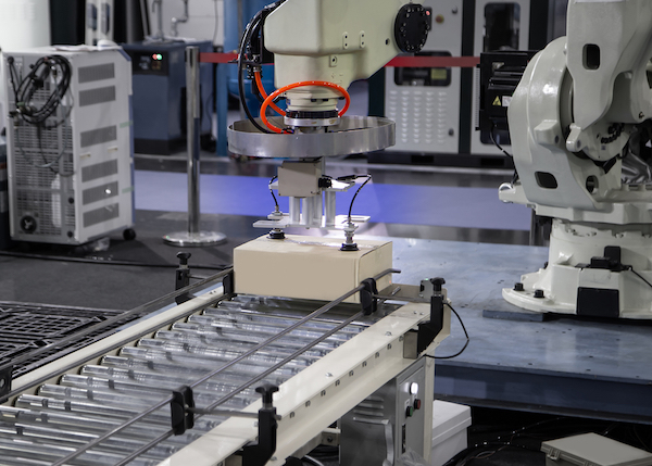 Robotic arm in factory assembly line.