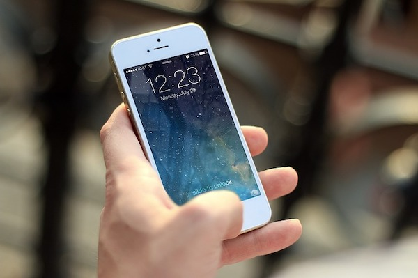 An iPhone being held
