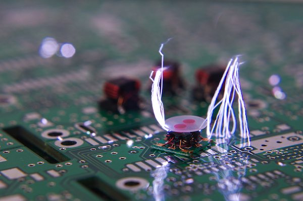 Electrostatic discharge or ESD flying from an electronic component.
