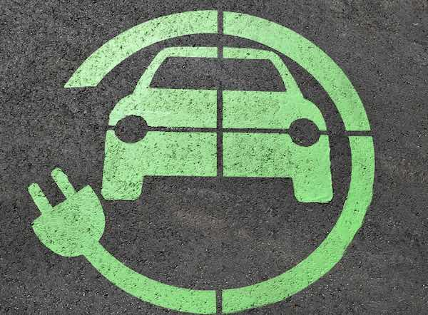 A green symbol of a plug-in electric vehicle