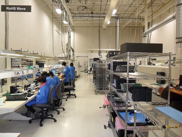 Workers on production floor.